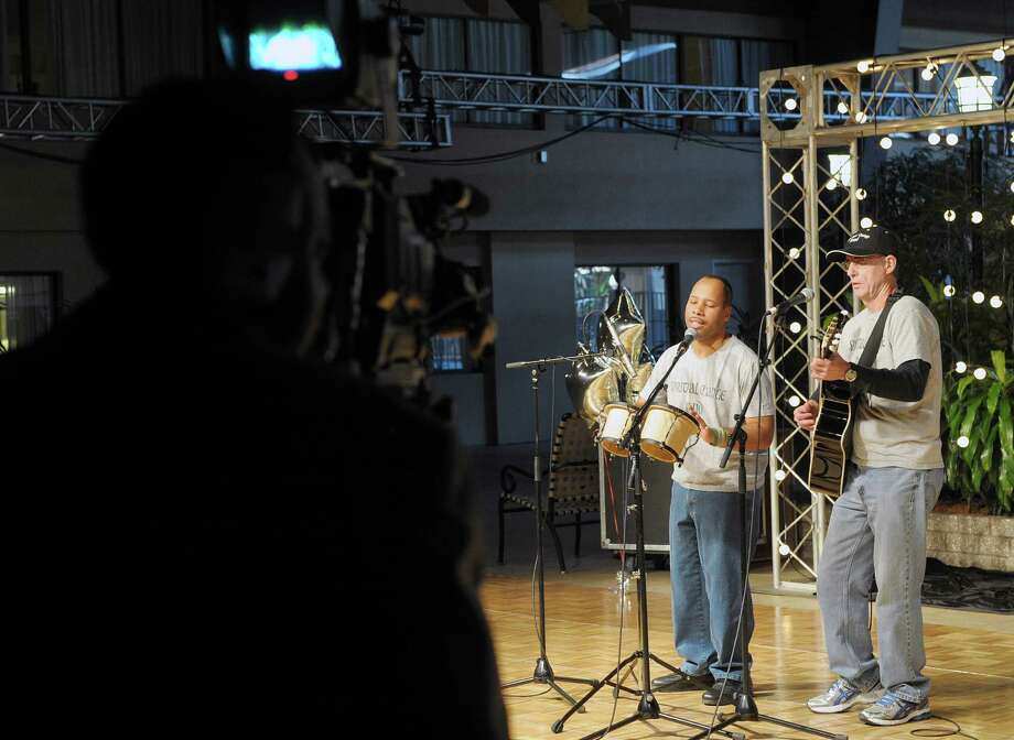 Members of the group Spiritual Change Band, John Schwartz, left, of Ballston Lake, and Bob Demers, of Waterford perform during the 53rd Annual Center for Disability Services Telethon at the Holiday Inn on Sunday, Jan. 27, 2013 in Albany, NY.  Schwartz is a graduate of the center.   (Paul Buckowski / Times Union) ORG XMIT: MER2013120513240092 Photo: Paul Buckowski / 00020922A