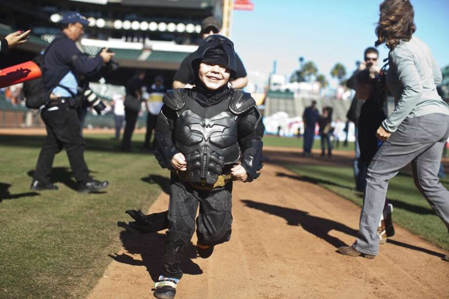 SAN FRANCISCO, CA - NOVEMBER 15: Leukemia survivor Miles, 5, dressed as BatKid, runs the bases as part of a Make-A-Wish foundation fulfillment at AT&T Park November 15, 2013 in San Francisco. The Make-A-Wish Greater Bay Area foundation turned the city into Gotham City for Miles by creating a day-long event bringing his wish to be BatKid to life. (Photo by Ramin Talaie/Getty Images) Photo: Ramin Talaie, Getty Images