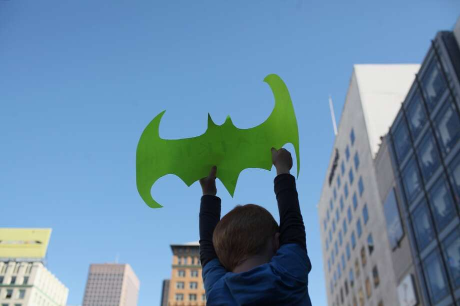 A young boy held a Batman cut out in Union Square during a Make-a-Wish benefit where Miles Scott, 5 saves Gotham as Batkid in San Francisco, Calif., Friday November 16, 2013. Photo: Jason Henry, Special To The Chronicle