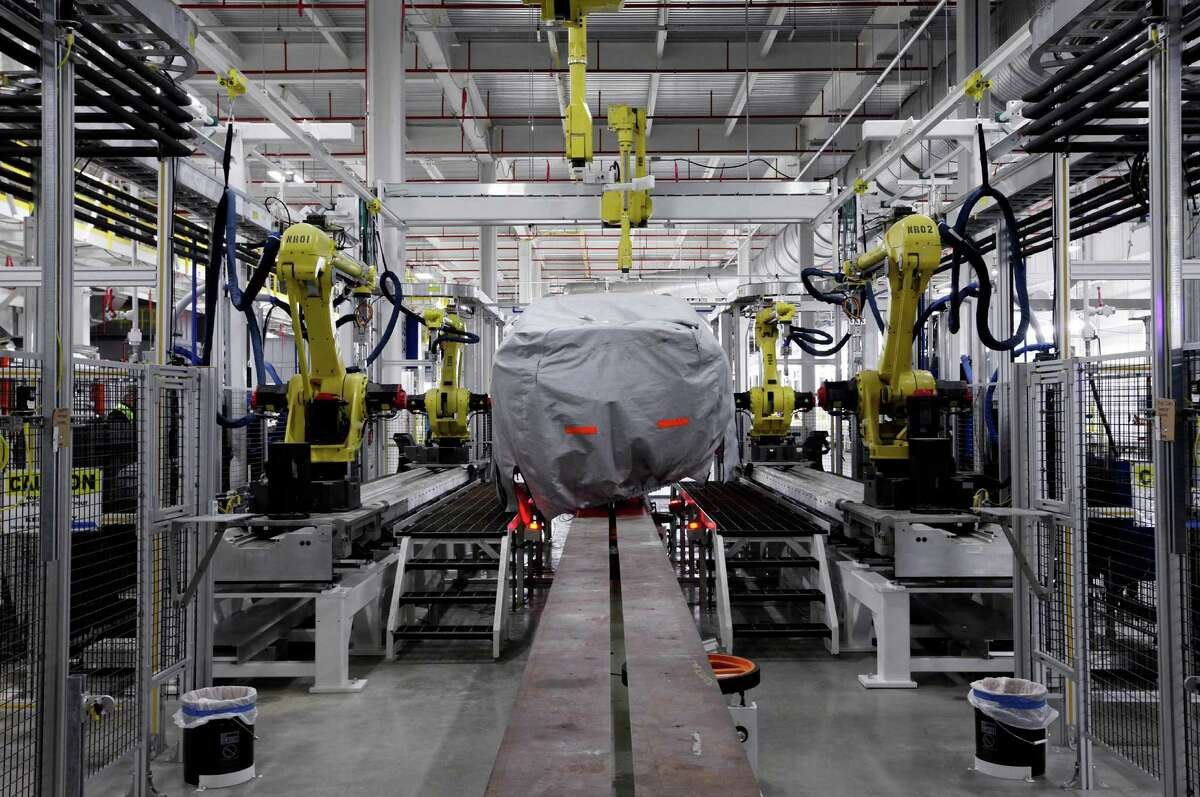 A vehicle sits in part of the new paint shop at Chrysler's Sterling Heights Assembly Plant in Michigan. Auto sales are among positive factors in the economy.