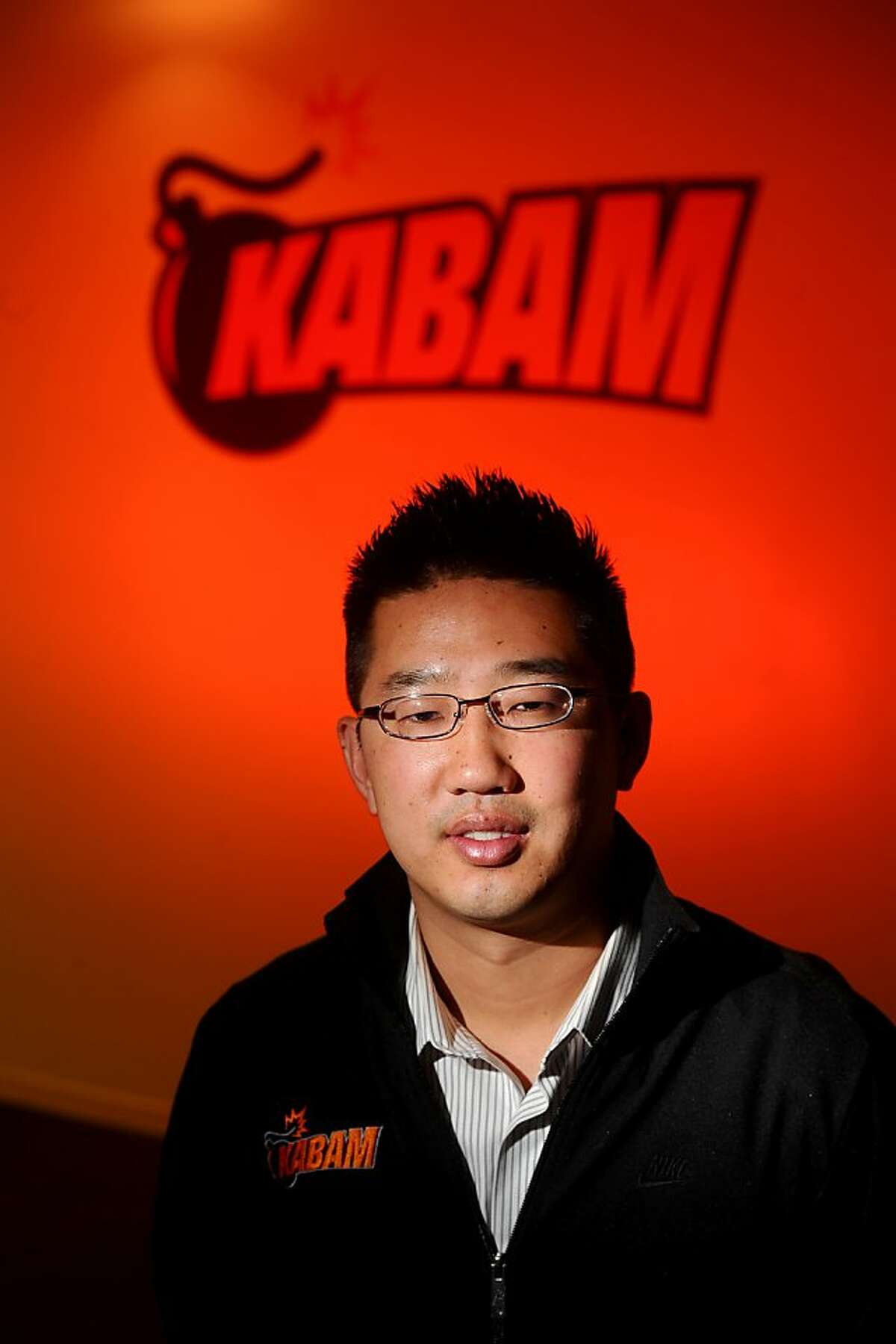 Kevin Chou, chief executive officer of Kabam, poses at his company's offices in Redwood City, California, U.S., on Tuesday, May 24, 2011. Photographer: Noah Berger/Bloomberg News.