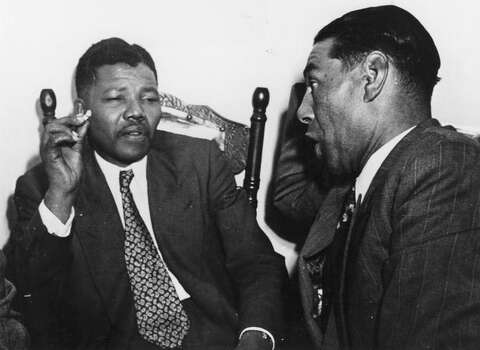 Circa 1964: Nelson Mandela, President of the African National Congress (left) in discussion with C Andrews, a Cape Town teacher. Photo: Getty Images