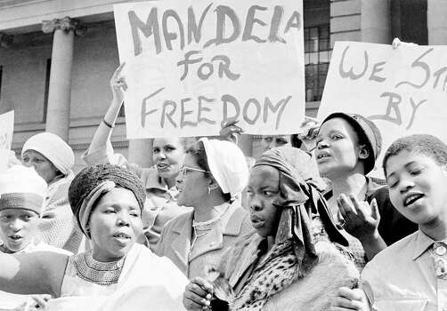 "African women join in a demonstration in South Africa in 1962, demanding the release of Nelson Mandela, former secretary of the banned African National Congress, who appeared in court on a charge of incitement.  The women, together with Winnie Mandela chanted ""down with Verwoerd on the steps of the Johannesburg City Hall. Photo: Dennis Lee Royle, Wire / 1962 AP"