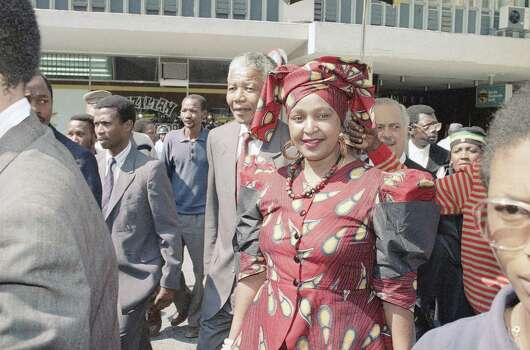 Winnie Mandela, front, wife of African National Congress leader Nelson Mandela, back left, arrives at the Rand Supreme Court  Thursday, Feb. 14, 1991, where she is charged with kidnapping and assault. Key states witnesses, fearing for their safety, have refused to testify. The case continues. Photo: Anonymous, Wire / AP1991