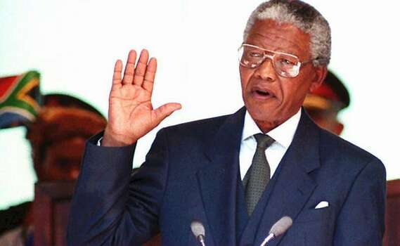 South African President Nelson Mandela takes the oath in May 1994 during his inauguration at the Union Building in Pretoria, South Africa. Mandela was elected as the nation's first black president during the first session of the country's post-apartheid parliament 09 May in Cape Town. Photo: Getty Images