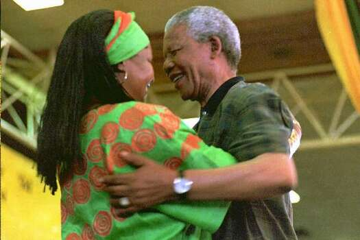 South African President Nelson Mandela (R) congratulates his wife Winnie after she has been elected to the National Executive Committee of the African National Congress (ANC) on the last day of its 49th constitutional congress in Bloemfontein, South Africa, 21 December 1994. The Mandela's have been separated since 1992. Photo: Getty Images