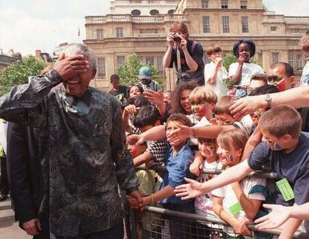 South African President Nelson Mandela goes on a walkabout round Trafalgar Square in London on his way to South Africa House, where he made a speech from the balcony to the crowds. Mandela was on the last day of his four-day state visit to the UK. Photo: Getty Images