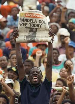 Photo taken 11 February 1990 shows a jubilant Sowetan holding up a newspaper announcing the release of African National Congress (ANC) leader Nelson Mandela, at a mass ANC rally in Soweto. Soweto, South Africa's most famous township and the former home to South Africa's most famous son, Nelson Mandela is to celebrate its centenary this week. Photo: Getty Images
