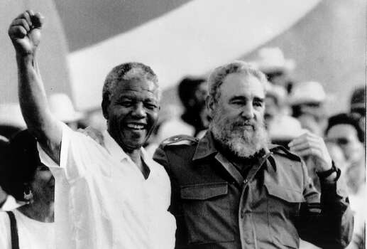 "Cuban President Fidel Castro, right, and African leader Nelson Mandela gesture during the celebration of the ""Day of the Revolution"" in Matanzas Saturday, July 27, 1991. Cubans celebrate 38th anniversary of the revolution. Photo: ALEJANDRO BALAGUER, Wire / AP1991"