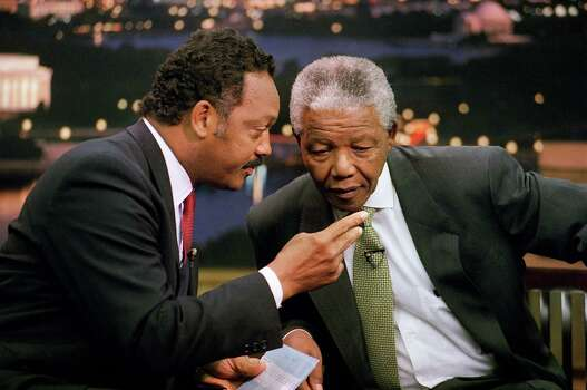 Rev. Jesse Jackson leans over to talk to African National Congress President Nelson Mandela prior to the taping of Jackson?s ?Both Sides? show at CNN studios in Washington Saturday, Sept. 25, 1993. The show will be broadcast 9 p.m. EDT Saturday. Photo: Shayna Brennan, Wire / 1993 AP