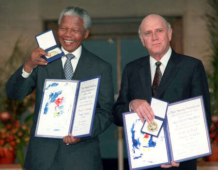 "South African Deputy President F.W. de Klerk, right, and South African President Nelson Mandela pose with their Nobel Peace Prize Gold Medal and Diploma, in Oslo. For Nobel Peace Prize laureate F.W. De Klerk, football in South Africa has changed as much as the country itself. From growing up in an uppercrust white setting and never considering playing the sport, to the reality of today with every hue of the ""rainbow nation"" rooting for Bafana Bafana at the World Cup, the former president has witnessed an amazing transformation.  ""Regardless of race, culture, language or economic background, we shall all be cheering for Bafana Bafana,"" the 74-year-old De Klerk wrote in an e-mail exchange with The Associated Press. Photo: Jon Eeg, Wire / AP1997"