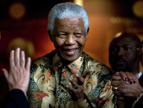 In this Oct. 6, 2007 file photo, former South African President Nelson Mandela reacts as German Chancellor Angela Merkel, left, waves farewell after a meeting at the Nelson Mandela Foundation building in Johannesburg, South Africa.  Former South African President Nelson Mandela has been hospitalized with a stomach ailment, according to a government statement issued Saturday Feb. 25, 2012 about the 93-year-old anti-apartheid icon. Photo: Peter Dejong, Wire / AP2007