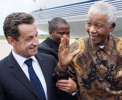 French President Nicolas Sarkozy, left, welcomes former South African president Nelson Mandela, right, upon his arrival, at Paris Orly airport, Monday, Sept. 3, 2007. Mandela is on a three-day visit to Paris. Photo: THOMAS COEX, Wire / AP2007