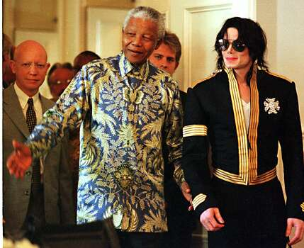 South African President Nelson Mandela, left, and American pop singer Michael Jackson arrive at a news conference in Cape Town Tuesday, March 23, 1999. Jackson announced dates for two concerts in June of which profits will go to various funds including the Nelson Mandela Children's Fund. Photo: OBED ZILWA, Wire / 1999 AP