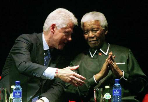 Former South African President Nelson Mandela, right, with former U.S. President Bill Clinton, left, during the Nelson Mandela Annual Lecture in honor of Mandela who turned 87 Monday in Johannesburg, South Africa, Tuesday, July 19, 2005. Photo: THEMBA HADEBE, Wire / AP