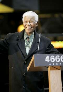 "Nelson Mandela speaks on stage at the ""46664 Arctic"" concert, at Fyllingen on June 11, 2005 in Tromso, Norway. The fourth concert aims to raise awareness of and funds for the global HIV/AIDS pandemic, as well as funds for South Africa with proceeds going to the Nelson Mandela Foundation. Produced by Robbie Williams, it follows 3 previous concerts held in Cape Town, George and Madrid, and Mandela is expected to make a personal plea to leaders of the G8 summit in his address. Photo: Getty Images"