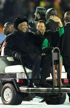 Former South Africa President Nelson Mandela and wife Graca Machel wave to the crowds prior to the 2010 FIFA World Cup South Africa Final match between Netherlands and Spain at Soccer City Stadium on July 11, 2010 in Johannesburg, South Africa. Photo: Getty Images