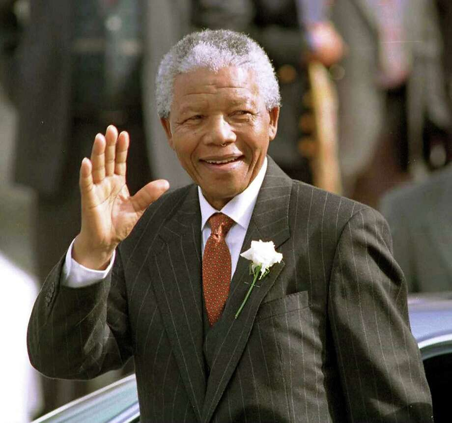 South African President Nelson Mandela makes his way to Parliament in Cape Town, South Africa, in this May 9, 1994, file photo. Mandela died on Thursday. He became an icon for freedom and equality. Photo: McClatchy-Tribune News Service / Los Angeles Times