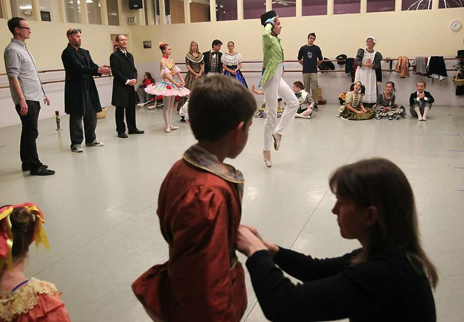 "Karen Dunn adjusts 10-year-old Miles O'Crowley's costume, one of nearly 200 that were made for this year's ""Nutcracker."" Photo: Leah Millis, The Chronicle"