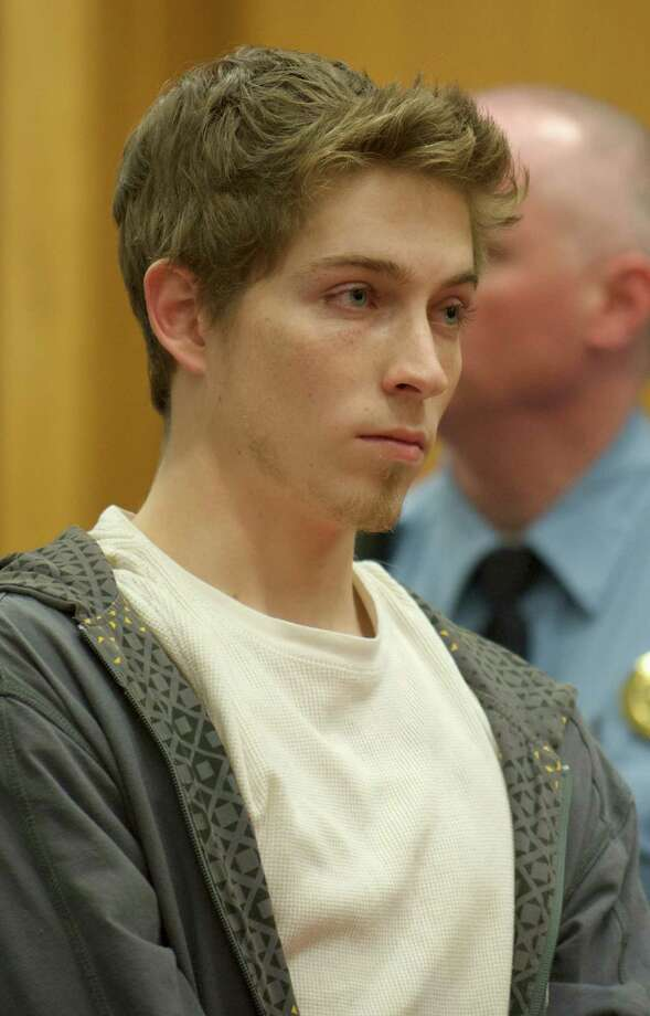 Alexander Lee, 21, appears in superior court in Danbury, Conn, on Wednesday , December 4, 2013,for his arraignment on charges he fled the scene after a cyclist from Weston hit his car on Route 302 in Bethel earlier this year. He was held on $150,000 bail. Photo: H John Voorhees III / The News-Times Freelance