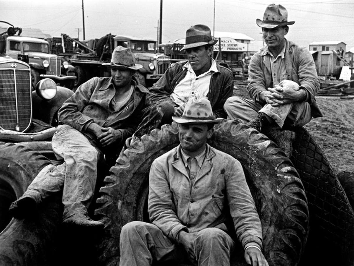 Life during the early Texas oil booms Roustabouts take time off from their job in oil boom town Freer. (Photo by Carl Mydans/Time & Life Pictures/Getty Images)