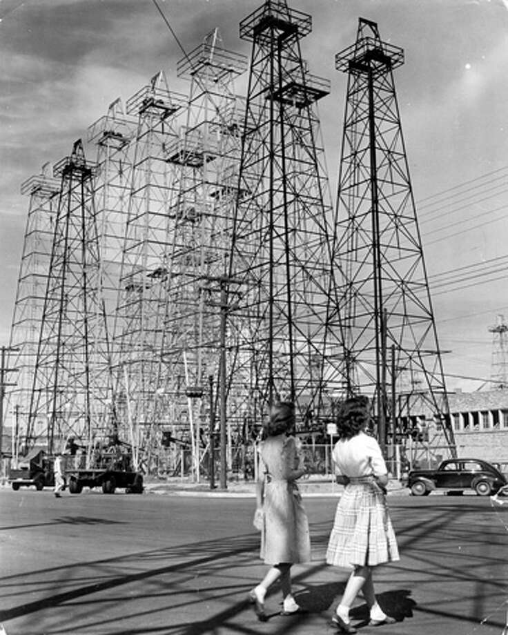 Young women pass a row of oil derricks in Kilgore.  (Photo by Alfred Eisenstaedt/Time & Life Pictures/Getty Images) Photo: Alfred Eisenstaedt, Time & Life Pictures/Getty Image / Time & Life Pictures/Getty Images
