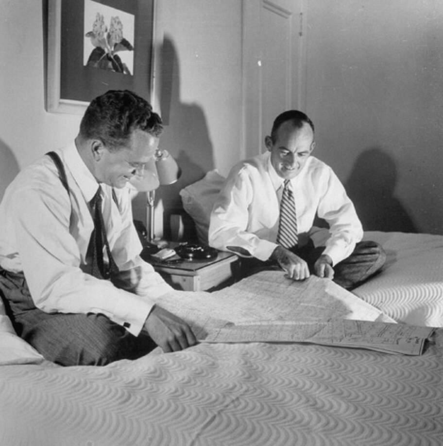 Notre Dame classmates Bill Castleman (L) and Joe O'Neil, who have each left their careers to set up as oil lease dealers, examining lease map  (Photo by Joseph Scherschel//Time Life Pictures/Getty Images) Photo: Joseph Scherschel, Time & Life Pictures/Getty Image / Time Life Pictures