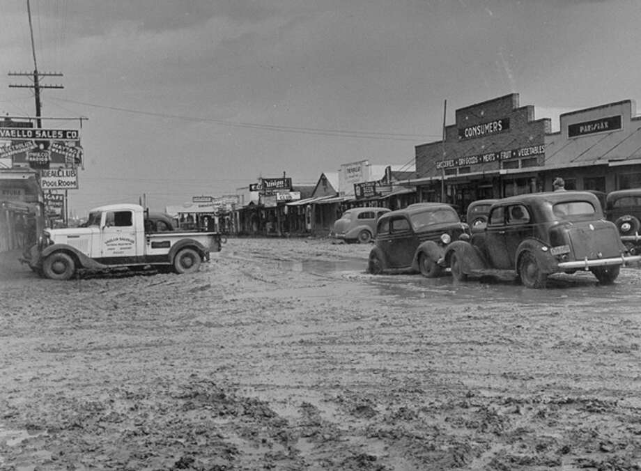 Muddy main street in Freer.  (Photo by Carl Mydans//Time Life Pictures/Getty Images) Photo: Carl Mydans, Time & Life Pictures/Getty Image / Time Life Pictures
