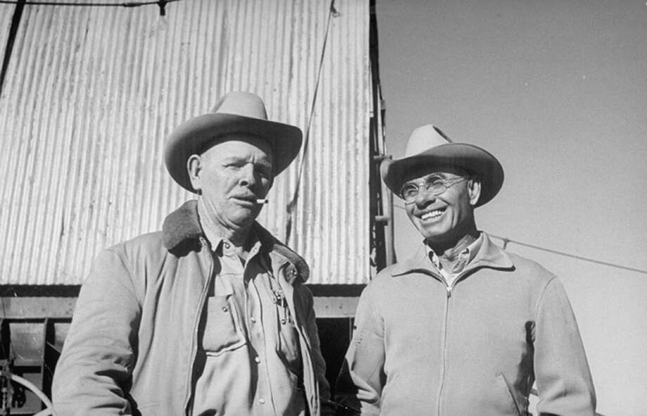 Farmer and oil well owner Joe York (right) standing with neighbor Arthur Townsend.  (Photo by Joseph Scherschel//Time Life Pictures/Getty Images) Photo: Joseph Scherschel, Time & Life Pictures/Getty Image / Time Life Pictures
