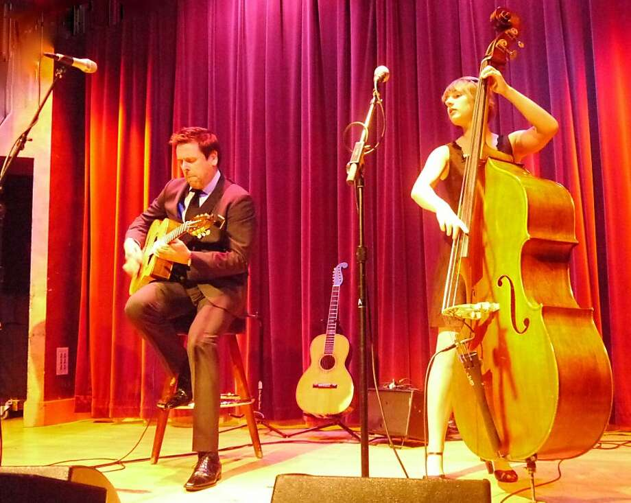 "Guitarist George Cole, a former rocker now into Gypsy jazz, performs his ""Holiday for Swingers"" at Yoshi's on Wednesday with Kaeli Earle (right), violinist Mads Tolling and others. Photo: Courtesy George Cole"