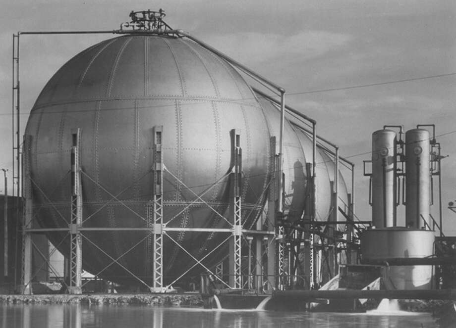 View of storage tanks at a Texaco oil refinery.  (Photo by Margaret Bourke-White/Pictures Inc./Time Life Pictures/Getty Images) Photo: Margaret Bourke-White, Time & Life Pictures/Getty Image / Time Life Pictures