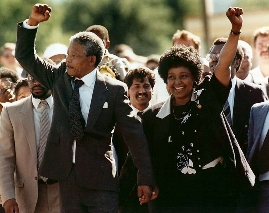 A triumphant Nelson Mandela celebrates with his wife, Winnie, as he leaves South Africa's Victor Verster prison, after spending 27 years of his life behind bars. Photo: Greg English, Associated Press