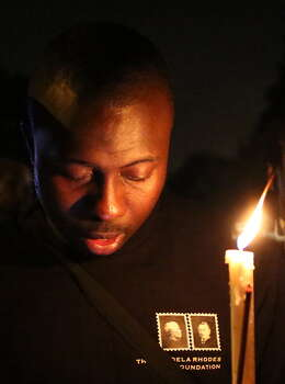A man holds a candle outside the house of former South African president Nelson Mandela following his death in Johannesburg on December 5, 2013. Mandela, the revered icon of the anti-apartheid struggle in South Africa and one of the towering political figures of the 20th century, has died aged 95. Mandela, who was elected South Africa's first black president after spending nearly three decades in prison, had been receiving treatment for a lung infection at his Johannesburg home since September, after three months in hospital in a critical state.  Photo: ALEXANDER JOE, Getty Images / 2013 AFP
