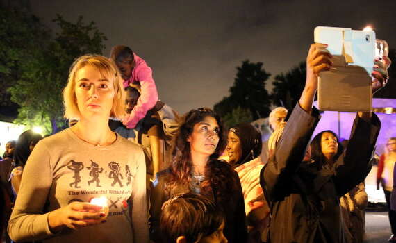 South Africans gather for a candlelight vigil outside the house of former South African president Nelson Mandela following his death in Johannesburg on December 5, 2013. Mandela, the revered icon of the anti-apartheid struggle in South Africa and one of the towering political figures of the 20th century, has died aged 95. Mandela, who was elected South Africa's first black president after spending nearly three decades in prison, had been receiving treatment for a lung infection at his Johannesburg home since September, after three months in hospital in a critical state. Photo: ALEXANDER JOE, Getty Images / 2013 AFP
