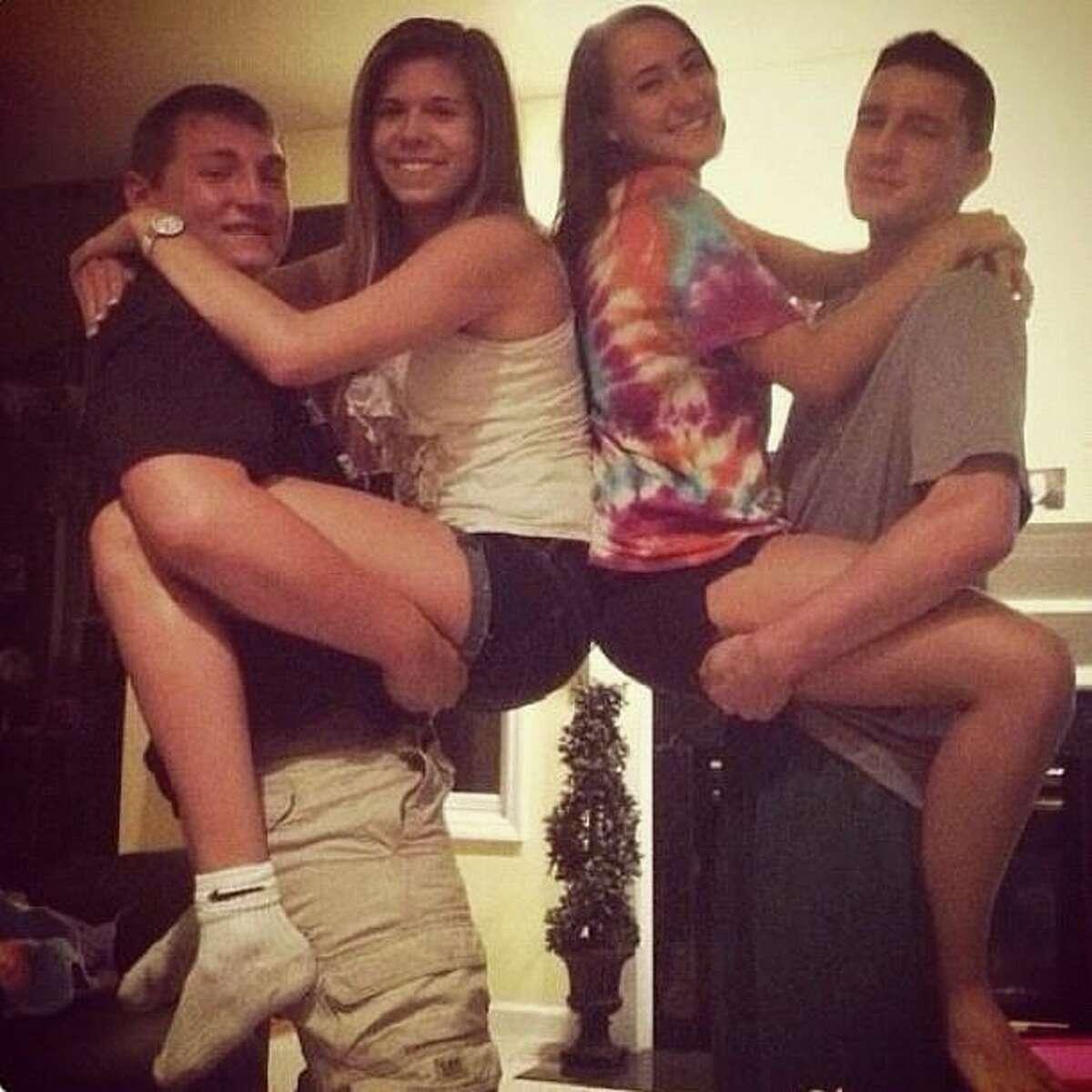 Photo of Shenendehowa senior Chris Stewart, left, holding Shaker High School senior Bailey Wind, and Shenendehowa senior Matt Hardy holding Shenendehowa senior Deanna Rivers. They were all involved in a car crash on the Northway Dec. 1, 2012. Stewart and Rivers were killed. (Facebook)