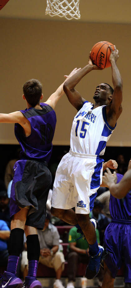 Ozen's Demasters Sam, No. 15, goes up for the basket while Lufkin's Davis Robinson, No. 10, tries for a block Thursday. The Ozen High School boys basketball team played against Lufkin during the YMBL Tournament at Lamar University on Thursday. Photo taken Jake Daniels/@JakeD_in_SETX Photo: Jake Daniels / ©2013 The Beaumont Enterprise/Jake Daniels