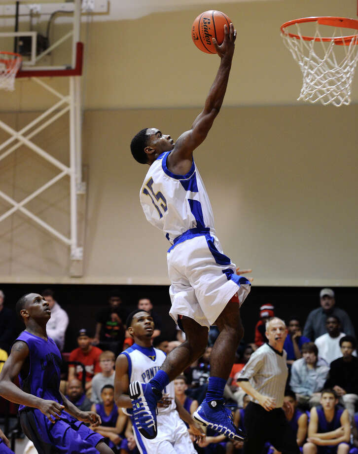 Ozen's Demasters Sam, No. 15, glides upward toward the goal during Thursday's match up with Lufkin. The Ozen High School boys basketball team played against Lufkin during the YMBL Tournament at Lamar University on Thursday. Photo taken Jake Daniels/@JakeD_in_SETX Photo: Jake Daniels / ©2013 The Beaumont Enterprise/Jake Daniels