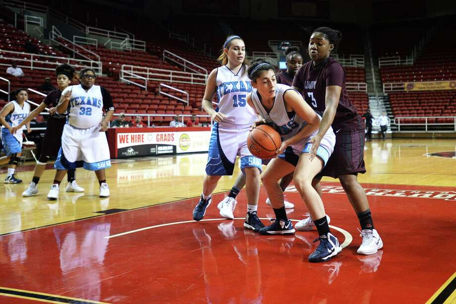 Central Lady Jaguars Breasia Allison guards against Sam Rayburn Texans during the first period at Montagne Center Thursday. The Jaguars went on to win the game 45-23.  Michael Rivera/@michaelrivera88