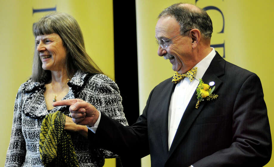 R. Bowen Loftin, with his wife, Karin, was introduced as Missouri's new chancellor on Thursday in Columbia, Mo. Loftin was a key figure in the Aggies' move to the Southeastern Conference and the hiring of coach Kevin Sumlin. Photo: Kholood Eid, MBR / Columbia Missourian