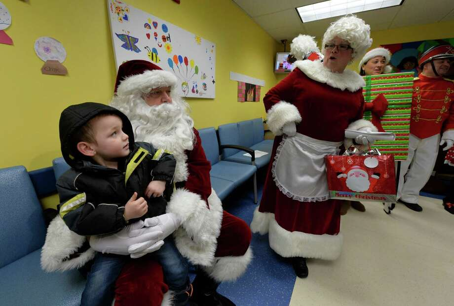 Three year old Cameron McHarg is entertained by Santa and Mrs. Santa Thursday morning, Dec. 5, 2013, at the Pediatrics Unit of the Albany Medical Center in Albany, N.Y. (Skip Dickstein/Times Union) Photo: SKIP DICKSTEIN / 00024914A