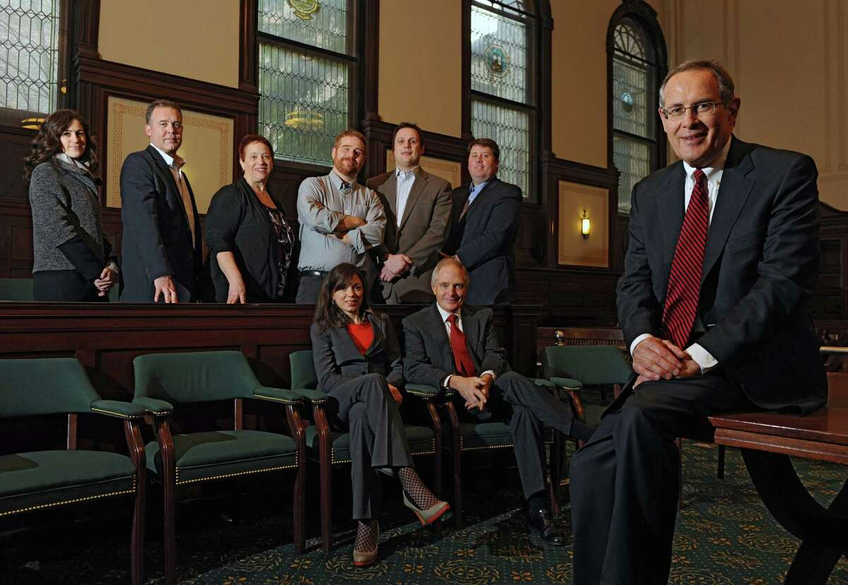 Back row from left, Julie Byrne Smith, David Baecker, Kathryn Sheehan, Duncan Crary, Jake Dumesnil, Tom Nardacci, Molly Casey and Jack Casy, sitting, and attorney E. Stewart Jones make up the group of people involved in staging a mock trial Livingston v. Moore on Dec. 18 in Rensselaer County Courthouse on Thursday, Dec. 5, 2013 in Troy, N.Y. The trial was to resolve the dispute over authorship of