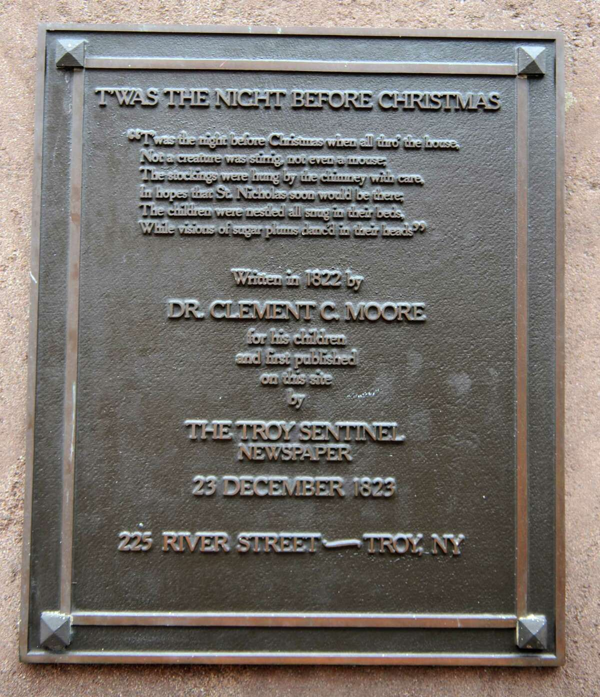 Plaque about poem and Clement C. Moore as author outside former Troy Sentinel newspaper office, 225 River St. on Thursday, Dec. 5, 2013 in Troy, N.Y. A group of people are involved in staging a mock trial Livingston v. Moore on Dec. 18 in Rensselaer County Courthouse. The trial was to resolve the dispute over authorship of