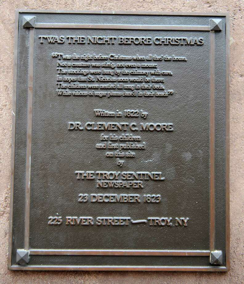 "Plaque about poem and Clement C. Moore as author outside former Troy Sentinel newspaper office, 225 River St. on Thursday, Dec. 5, 2013 in Troy, N.Y. A group of people are involved in staging a mock trial Livingston v. Moore on Dec. 18 in Rensselaer County Courthouse. The trial was to resolve the dispute over authorship of ""Twas the Night Before Christmas"" published in 1823 in the Troy Sentinel. (Lori Van Buren / Times Union) Photo: Lori Van Buren / 00024918A"
