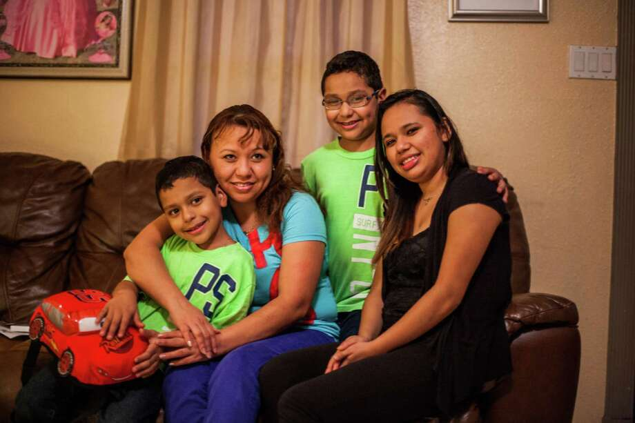 Alexander Ramirez, 8; Francisca Ortega; Alexis Ramirez, 8; and Karen Ramirez, 19, live on the south side of Houston. Ortega and Ramirez both work, but times are tough. Goodfellows is helping with toys for the twins. Photo: Michael Starghill, Jr., Photographer / © 2013 Michael Starghill, Jr.