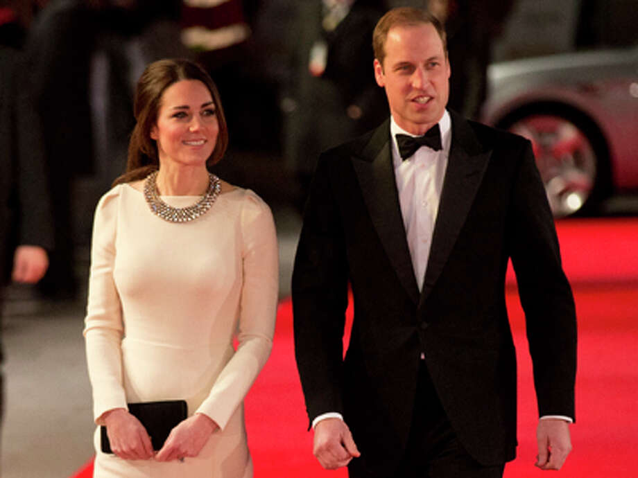 """Britain's Kate, Duchess of Cambridge and her husband Prince William arrive to attend the UK premiere of the movie """"Mandela: Long Walk to Freedom"""" at a cinema in London, Thursday, Dec. 5, 2013. Photo: Matt Dunham, AP / AP"""