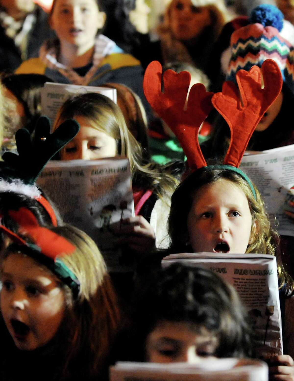 Saratoga Area Girl Scouts sing Chrismas carols during the Victorian Streetwalk on Thursday, Dec. 5, 2013, in Saratoga Springs, N.Y. (Cindy Schultz / Times Union)