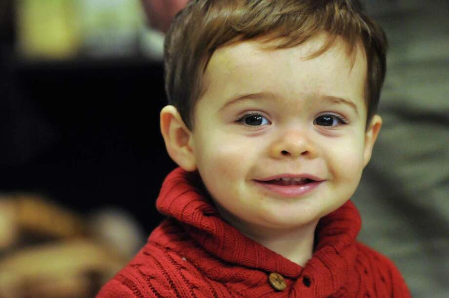 Liam Donnarumma, 15 months old, of Saratoga Springs listens to Betsy and the ByeGons perform inside Fallon Wellness Pharmacy during the Victorian Streetwalk on Thursday, Dec. 5, 2013, in Saratoga Springs, N.Y. (Cindy Schultz / Times Union) Photo: Cindy Schultz / 00024871A