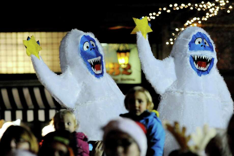 Abominable Snowmen make an appearance during the Victorian Streetwalk on Thursday, Dec. 5, 2013, in Saratoga Springs, N.Y. (Cindy Schultz / Times Union) Photo: Cindy Schultz / 00024871A