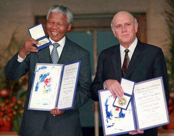 FILE - In this Dec. 10, 1993 file photo, South African Deputy President F.W. de Klerk, right, and South African President Nelson Mandela pose with their Nobel Peace Prize Gold Medals and Diplomas in Oslo.   South Africa's president Jacob Zuma says, Thursday, Dec. 5, 2013, that Mandela has died. He was 95.  (AP Photo/NTB, File) Photo: JON EEG, STF / NTB