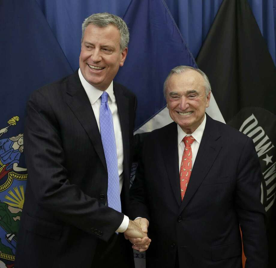 "William Braton, right, poses for a picture with New York Mayor-elect Bill de Blasio during a news conference in New York, Thursday, Dec. 5, 2013. Bratton, whose tenure as New York City police commissioner in the 1990s was marked by a steep decline in crime and clashes with then-Mayor Rudolph Giuliani, has been chosen to lead the nation's largest police force again. De Blasio announced the appointment Thursday, saying Bratton is a ""proven crime-fighter"" who knows how to keep the city safe. (AP Photo/Seth Wenig) ORG XMIT: NYSW118 Photo: Seth Wenig / AP"
